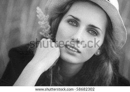 Young woman outdoors portrait. Black and white. - stock photo