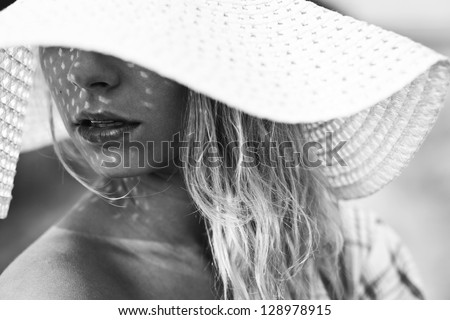 Young woman outdoors portrait. Black and white colors - stock photo