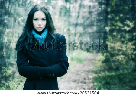 Young woman outdoors portrait. Grungy background with for aged photo effect. - stock photo