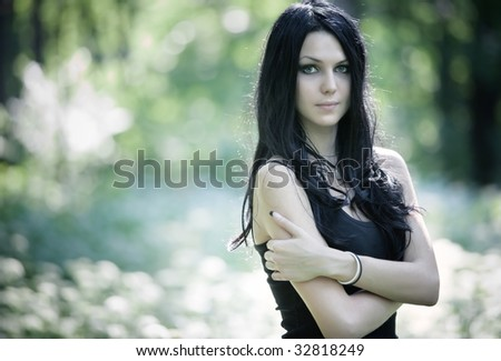 Young woman outdoors portrait. Shallow dof. - stock photo