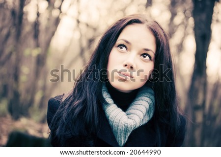 Young woman outdoors portrait. Soft red tint. - stock photo