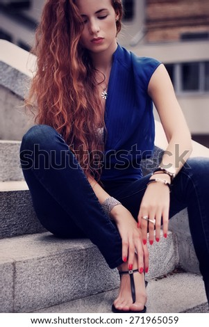 Young woman outdoors portrait. Soft sunny colors - stock photo
