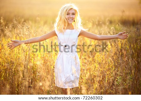 Young woman outdoors portrait. Sunny yellow colors. - stock photo
