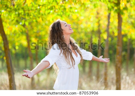 Young Woman Outside with Open Arms, Freedom Sensation - stock photo
