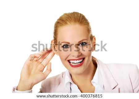 Young woman  overhears conversation and laughing - stock photo
