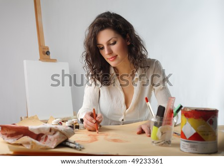 Young woman painting - stock photo