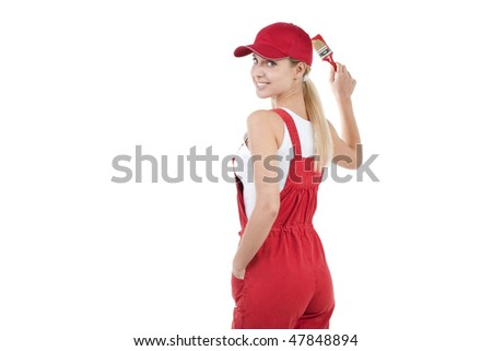 Young woman painting; copy space for your own red painting/mural