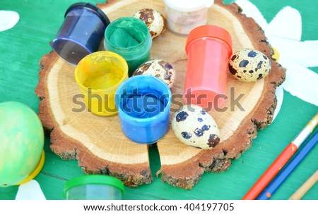 Young woman painting Easter eggs.easter, holidays, tradition and people concept .