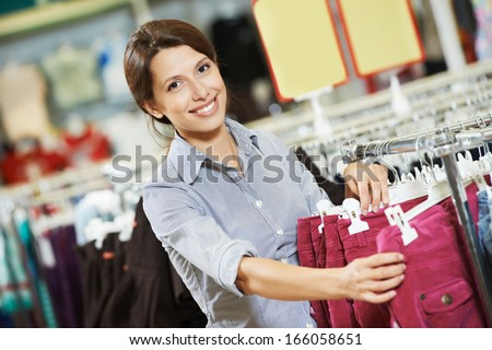 Young woman pants during clothing shopping at supermarket store - stock photo