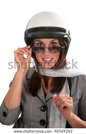 young woman peers over her sunglasses and smiles while wearing her motorcycle helmet, isolated on white - stock photo