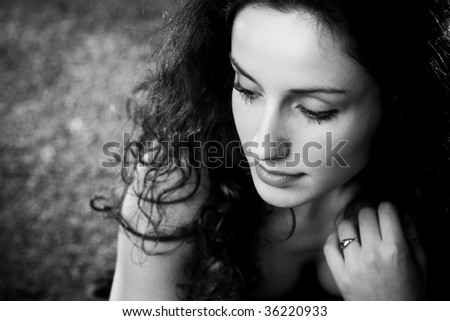Young woman pensive portrait. Black and white. - stock photo