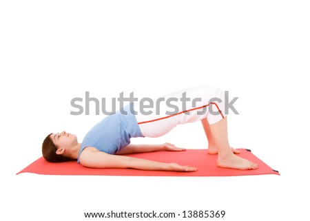 Young woman performing fitness exercises in the ground