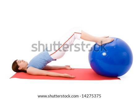 Young woman performing fitness exercises with a fitness ball - stock photo