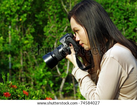 young woman photographer - stock photo
