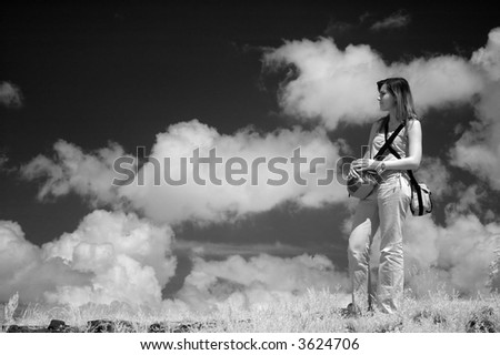 Young woman photographer get photographed in infra-red - stock photo