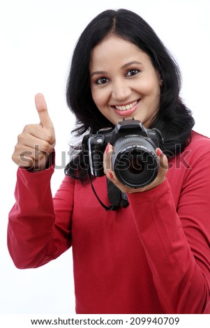 Young woman photographer taking images - stock photo