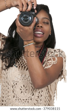 Young woman photographer with her dslr camera