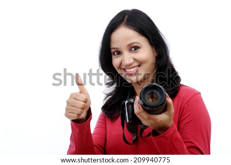 Young woman photographer with thumbs up gesture - stock photo