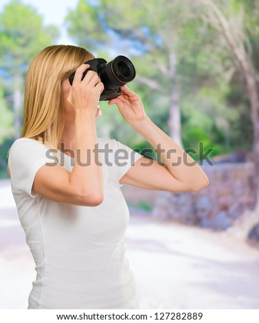 Young Woman Photographing at a park, outdoor - stock photo