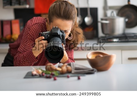 Young woman photographing food - stock photo