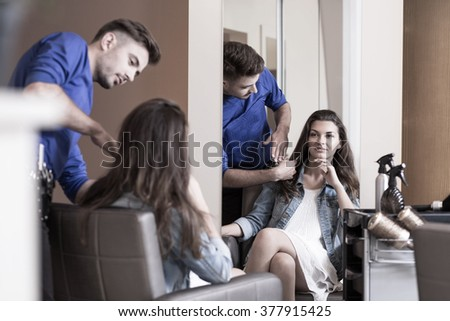 Young woman planning to cut hair at the hairdresser's - stock photo