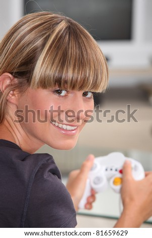 Young woman playing a video game - stock photo