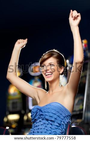 young woman playing celebrating arcade winning - stock photo