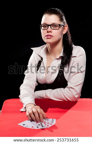 Young woman playing in the gambling in casino - stock photo