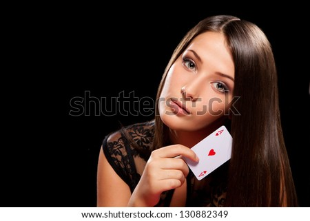 young woman playing in the gambling on black background with place for text