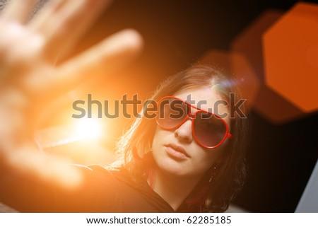 Young woman playing rockstar personality - stock photo