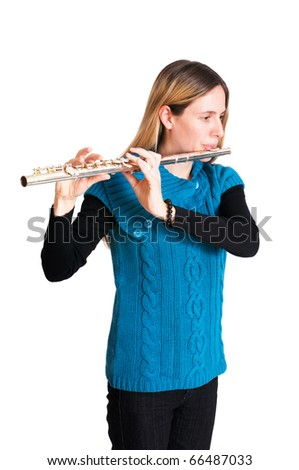 Young woman playing transverse flute isolated on white background. - stock photo