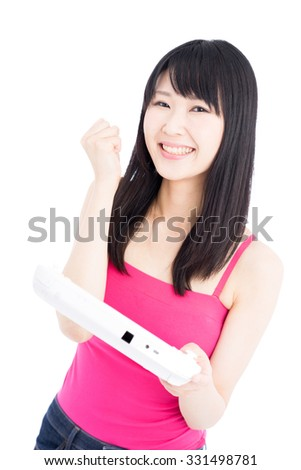 young woman playing video game isolated on white background