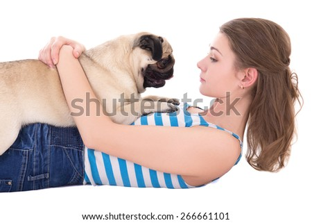 young woman playing with pug dog isolated on white background - stock photo