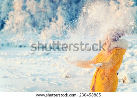 Young Woman playing with snow Outdoor Winter Lifestyle happiness emotions nature on background - stock photo