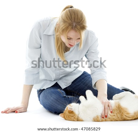 young woman playing with white ore cat - stock photo