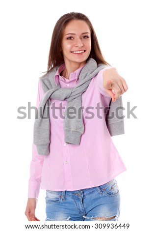 Young woman point finger at you  on white background