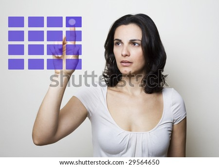 Young woman pointing a screen - stock photo
