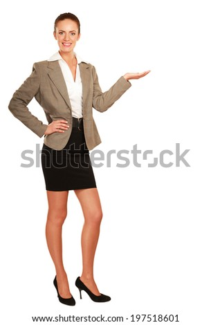 young woman pointing at something, isolated on white background