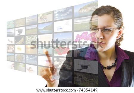 Young woman pointing multimedia screen, on white background - stock photo