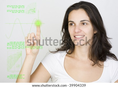 Young woman pointing on a virtual screen - stock photo