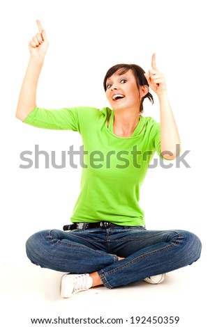young woman pointing, showing something, full lenght, white background - stock photo