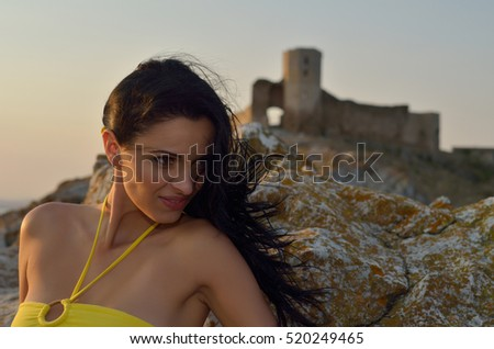 young woman portrait at sunset