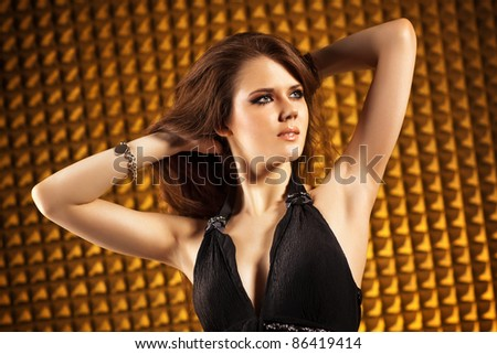 Young woman portrait. Golden colors. - stock photo