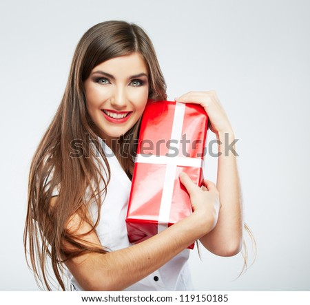 Young woman portrait hold christmas gift. Smiling happy girl on white background. Long hair female model. - stock photo