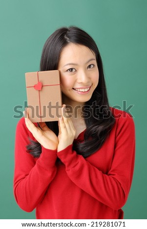 Young woman portrait hold gift in christmas color style . - stock photo