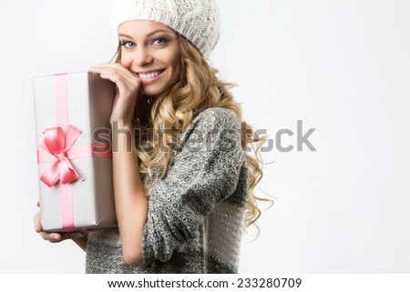 Young woman portrait hold gift. Smiling happy girl on white background. - stock photo