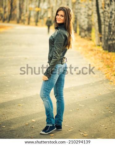 young woman portrait in autumn park  - stock photo