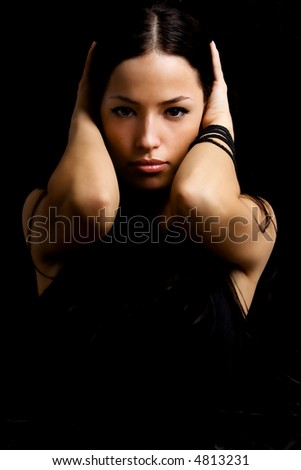 young woman portrait in dark - stock photo
