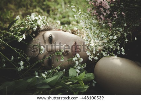 young woman portrait in flowers outdoor shot summer day