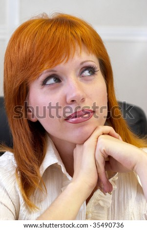 Young woman portrait in the office (white tone)